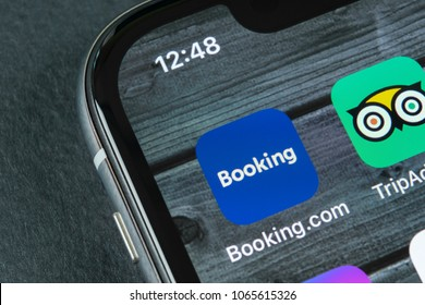 Sankt-Petersburg, Russia, April 10, 2018: Booking.com application icon on Apple iPhone X screen close-up. Booking app icon. Booking.com is  online website. Social media app