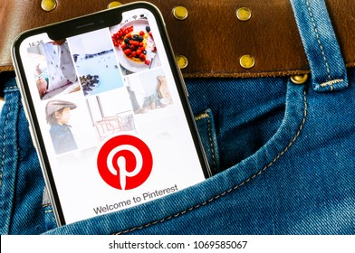 Sankt-Petersburg, Russia, April 14, 2018: Pinterest application icon on Apple iPhone X smartphone screen in jeans pocket. Pinterest app icon. Pinterest is Internet social network. Social media icon