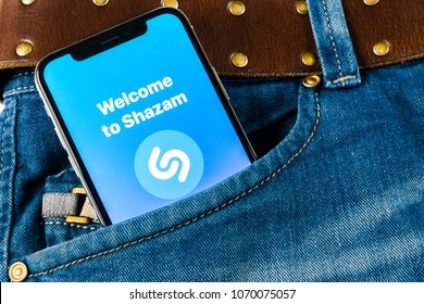 Sankt-Petersburg, Russia, April 14, 2018: Shazam application icon on Apple iPhone X screen close-up in jeans pocket. Shazam app icon. Shazam is popular online music application. Social media app
