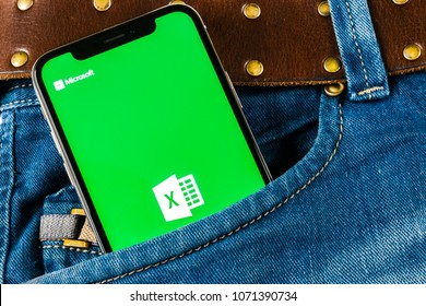 Sankt-Petersburg, Russia, April 14, 2018: Microsoft Exel application icon on Apple iPhone X screen in jeans pocket. Microsoft office Exel app icon. Microsoft office on mobile phone. Social media