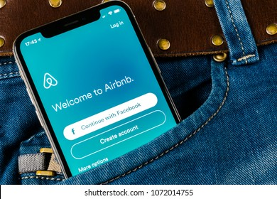 Sankt-Petersburg, Russia, April 14, 2018: Airbnb application icon on Apple iPhone X screen close-up in jeans pocket. Airbnb app icon. Airbnb.com is online site for booking rooms. social media network.