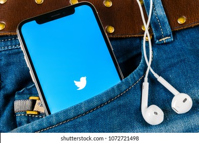 Sankt-Petersburg, Russia, April 14, 2018: Twitter application icon on Apple iPhone X smartphone screen close-up in jeans pocket. Twitter app icon. Social media icon. Social network