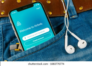 Sankt-Petersburg, Russia, April 14, 2018: Airbnb application icon on Apple iPhone X screen in jeans pocket. Airbnb app icon. Airbnb.com is online website for booking rooms. social media network.