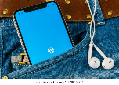 Sankt-Petersburg, Russia, April 14, 2018: Wordpress application icon on Apple iPhone X screen close-up in jeans pocket. Wordpress app icon. Wordpress.com application. Social network