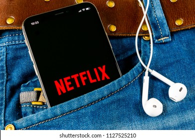 Sankt-Petersburg, Russia, April 14, 2018: Netflix application icon on Apple iPhone X screen close-up in jeans pocket. Netflix app icon. Netflix application. Social media network