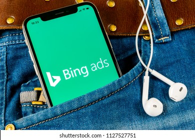 Sankt-Petersburg, Russia, April 14, 2018: Bing application icon on Apple iPhone X screen close-up in jeans pocket. Bing ads app icon. Bing ads is online advertising application. Social media network.