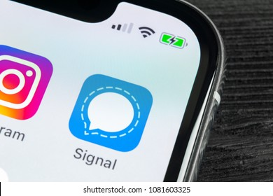 Sankt-Petersburg, Russia, April 27, 2018: Signal messenger application icon on Apple iPhone X smartphone screen close-up. Signal messenger app icon. Social media network.