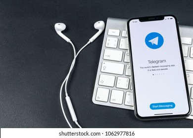 Sankt-Petersburg, Russia, April 6, 2018: Telegram application icon on Apple iPhone X screen close-up. Telegram app icon. Telegram is an online social media network. Social media app