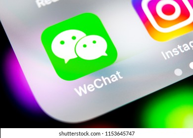Sankt-Petersburg, Russia, August 10, 2018: Wechat messenger application icon on Apple iPhone X smartphone screen close-up. Wechat messenger app icon. Social media network.