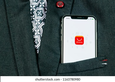 Sankt-Petersburg, Russia, August 24, 2018: Aliexpress application icon on Apple iPhone X smartphone screen in jacket pocket. Aliexpress app icon. Aliexpress.com is popular e-commerce application.