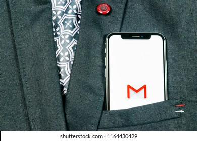 Sankt-Petersburg, Russia, August 24, 2018: Google Gmail application icon on Apple iPhone X smartphone screen  in jacket pocket. Gmail app icon. Gmail is  popular Internet online e-mail. Social media