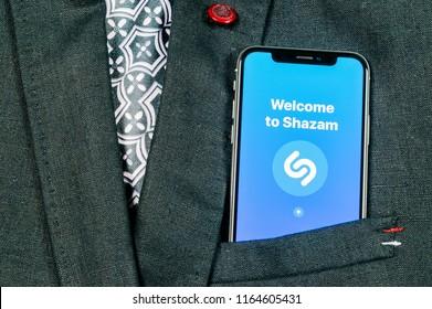 Sankt-Petersburg, Russia, August 24, 2018: Shazam application icon on Apple iPhone X screen close-up in jacket pocket. Shazam app icon. Shazam is popular online music application. Social media app