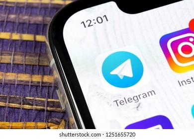 Sankt-Petersburg, Russia, December 5, 2018: Telegram application icon on Apple iPhone X screen close-up. Telegram app icon. Telegram is an online social media network. Social media app