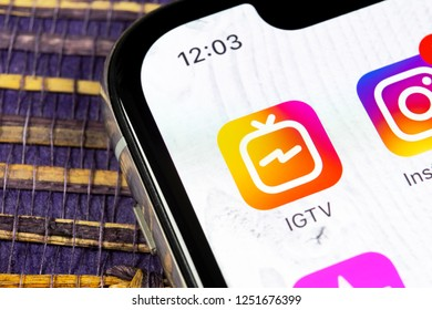Sankt-Petersburg, Russia, December 5, 2018: Apple iPhone X with social networking service IGTV Instagram on the smartphone screen. IGTV app icon. Social media icon. Social network. IGTV mobile app.