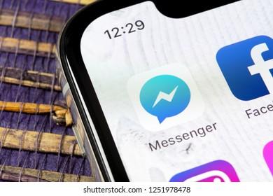 Sankt-Petersburg, Russia, December 5, 2018: Facebook messenger application icon on Apple iPhone X screen close-up. Facebook messenger app icon. Online internet social media network. Social media app