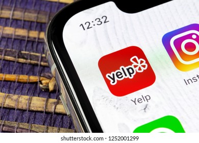 Sankt-Petersburg, Russia, December 5, 2018: Yelp application icon on Apple iPhone X screen close-up. Yelp app icon. Yelp.com application. Social network. Social media