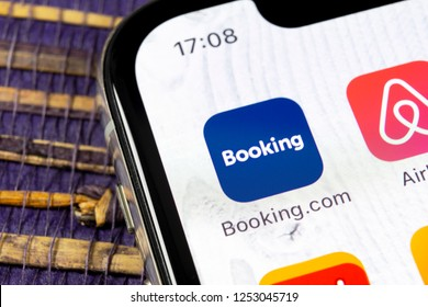 Sankt-Petersburg, Russia, December 5, 2018: Booking.com application icon on Apple iPhone X screen close-up. Booking app icon. Booking.com.  Social media app. Social network