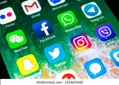 Sankt-Petersburg, Russia, February 16, 2019: Apple iPhone X with icons of social media facebook, instagram, twitter, snapchat application on screen. Social media icons. Social network