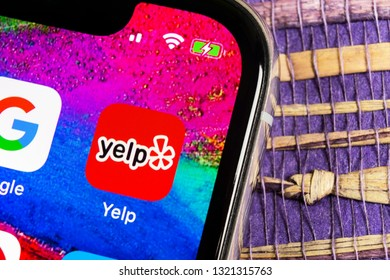 Sankt-Petersburg, Russia, February 17, 2019: Yelp application icon on Apple iPhone X screen close-up. Yelp app icon. Yelp.com application. Social network. Social media