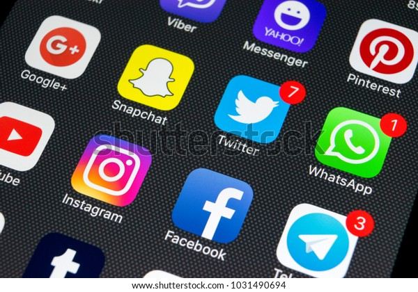 Sankt-Petersburg, Russia, February 23, 2018: Apple iPhone X with icons of social media facebook, instagram, twitter, snapchat application on screen. Social media icons. Social network