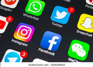 Sankt-Petersburg, Russia, February 25, 2018: Apple iPhone X with icons of social media facebook, instagram, twitter, snapchat application on screen. Social media icons. Social network