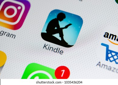 Sankt-Petersburg, Russia, February 28, 2018: Amazon Kindle application icon on Apple iPhone X screen close-up. Amazon Kindle app icon. Amazon kindle application. Social media network