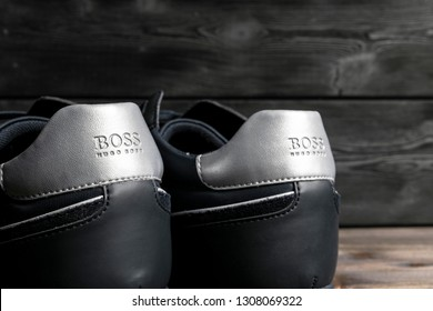 Sankt-Petersburg, Russia, February 6, 2018: Boss Hugo Boss logo on the modern leather sport shoes. Hugo Boss is the brand of the Fashion creator