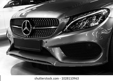 Sankt-Petersburg, Russia, January 12, 2018: Front view of a Mercedes Benz C 43 AMG 4Matic coupe V8 Bi-turbo 2018. Car exterior details. Black and white