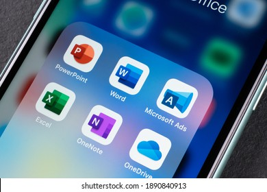 Sankt-Petersburg, Russia, January 4, 2021:  Microsoft office  applications icons on Apple iPhone 11 smartphone screen close-up. Apps word, excel, powerpoint, onedrive, ads, onenote