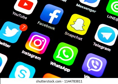 Sankt-Petersburg, Russia, July 29, 2018: Apple iPhone X with icons of social media facebook, instagram, twitter, snapchat, google application on screen. Social media icons. Social network