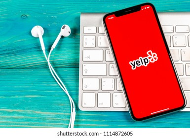 Sankt-Petersburg, Russia, June 2, 2018: Yelp application icon on Apple iPhone X screen close-up. Yelp app icon. Yelp.com application. Social network. Social media