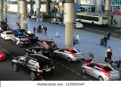 SANKT-PETERSBURG, RUSSIA - JUNE 29, 2018: Busiest airport. A large number of taxis are waiting for passengers from the flight in Pulkovo International airport in St Petersburg, Russia