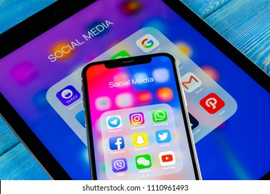Sankt-Petersburg, Russia June 8, 2018: Apple iPhone X and iPad with icons of social media facebook, instagram, twitter, snapchat application on screen. Social media icons. Social network. Social media