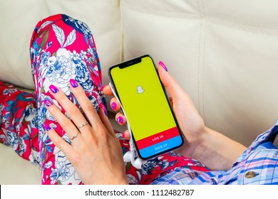 Sankt-Petersburg, Russia, June 8, 2018: Snapchat application icon on Apple iPhone X smartphone screen close-up in woman hands. Snapchat app icon. Social media icon. Social network