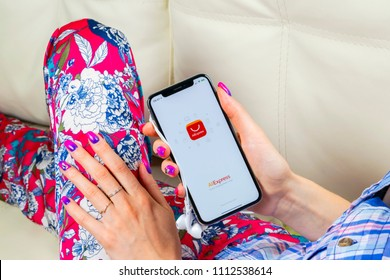 Sankt-Petersburg, Russia, June 8, 2018: Aliexpress application icon on Apple iPhone X smartphone screen in woman hands. Aliexpress app icon. Aliexpress.com is popular e-commerce application. Social