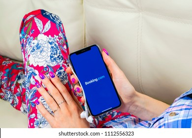 Sankt-Petersburg, Russia, June 8, 2018: Booking.com application icon on Apple iPhone X screen close-up in woman hands. Booking app icon. Booking.com.  Social media app. Social network