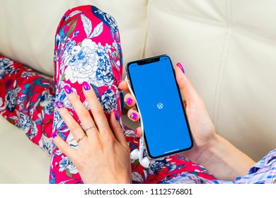 Sankt-Petersburg, Russia, June 8, 2018: Wordpress application icon on Apple iPhone X screen close-up in woman hands. Wordpress app icon. Wordpress.com application. Social network