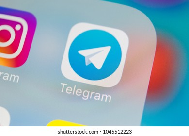Sankt-Petersburg, Russia, March 13, 2018: Telegram application icon on Apple iPhone X screen close-up. Telegram app icon. Telegram is an online social media network. Social media app