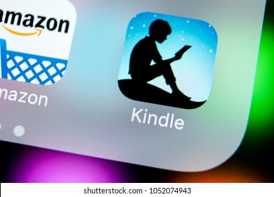Sankt-Petersburg, Russia, March 22, 2018: Amazon Kindle application icon on Apple iPhone X screen close-up. Amazon Kindle app icon. Amazon kindle application. Social media network