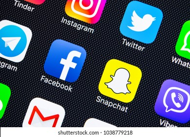 Sankt-Petersburg, Russia, March 5, 2018: Apple iPhone X with icons of social media facebook, instagram, twitter, snapchat application on screen. Social media icons. Social network