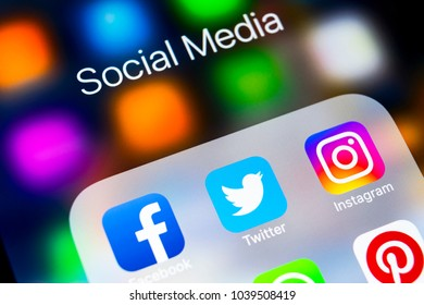 Sankt-Petersburg, Russia, March 6, 2018: Apple iPhone X with icons of social media facebook, instagram, twitter, snapchat application on screen. Social media icons. Social network