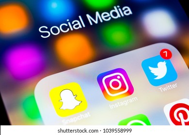 Sankt-Petersburg, Russia, March 6, 2018: Apple iPhone X with icons of social media facebook, instagram, twitter, snapchat application on screen. Social media icons. Social media network