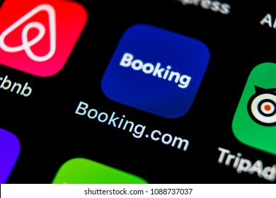 Sankt-Petersburg, Russia, May 10, 2018: Booking.com application icon on Apple iPhone X screen close-up. Booking app icon. Booking.com.  Social media app. Social network