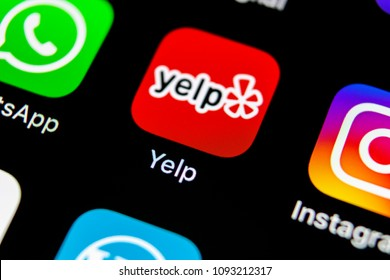 Sankt-Petersburg, Russia, May 10, 2018: Yelp application icon on Apple iPhone X screen close-up. Yelp app icon. Yelp.com application. Social network. Social media
