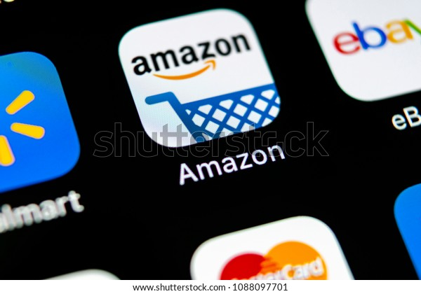 Sankt-Petersburg, Russia, May 10, 2018: Amazon shopping application icon on Apple iPhone X screen close-up. Amazon shopping app icon. Amazon mobile application. Social media network