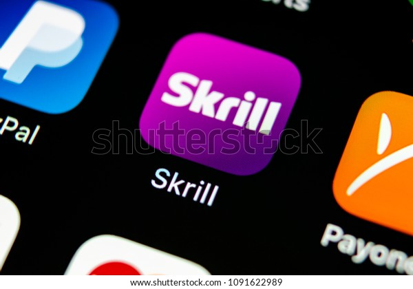 Sankt-Petersburg, Russia, May 10, 2018: Skrill application icon on Apple iPhone X smartphone screen close-up. Skrill app icon. Skrill is an online electronic finance payment system.