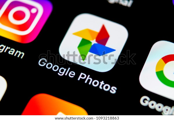 Sankt-Petersburg, Russia, May 10, 2018: Google Photos plus application icon on Apple iPhone X screen close-up. Google plus Photos icon. Google photos application. Social media network