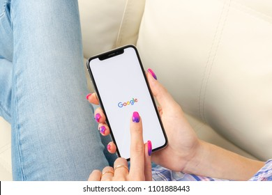 Sankt-Petersburg, Russia, May 30, 2018: Google search application icon on Apple iPhone X smartphone screen close-up in woman hands. Google app icon. Social network. Social media icon