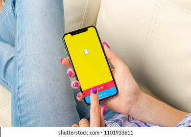 Sankt-Petersburg, Russia, May 30, 2018: Snapchat application icon on Apple iPhone X smartphone screen close-up in woman hands. Snapchat app icon. Social media icon. Social network