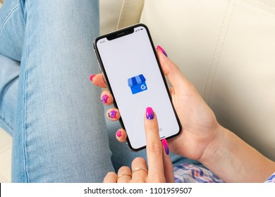 Sankt-Petersburg, Russia, May 30, 2018: Google My Business application icon on Apple iPhone X screen in woman hands. Google My Business icon. Google My business application. Social media network
